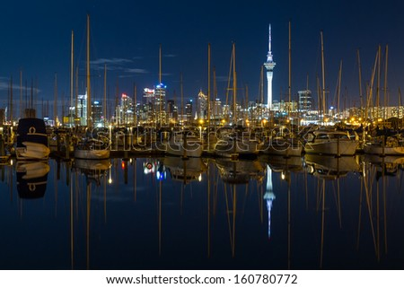 Westhaven Marina and Sky Tower at Night, Auckland, New Zealand - stock photo