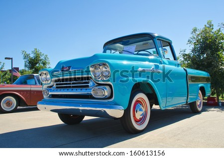 WESTLAKE, TEXAS - OCTOBER 19: A 1958 Chevrolet Apache pickup truck is on display at the 3rd Annual Westlake Classic Car Show on October 19, 2013 in Westlake, Texas. - stock photo
