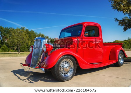 WESTLAKE, TEXAS - OCTOBER 18, 2014: A red 1935 Ford pickup truck is on display at the 4th Annual Westlake Classic Car Show. Front side view.  - stock photo