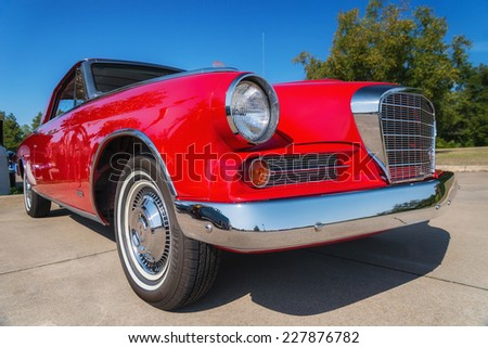 WESTLAKE, TEXAS - OCTOBER 18, 2014: A red 1963 Studebaker Gran Turismo is on display at the 4th Annual Westlake Classic Car Show. Closeup of front. - stock photo