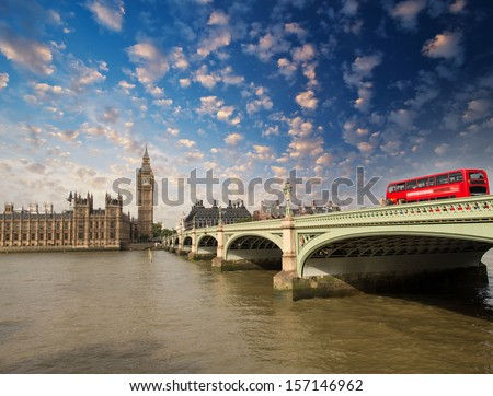 Westminster Bridge and Houses of Parliament at sunset, London. Beautiful view with red bus crossing the bridge. - stock photo