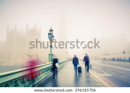 Westminster bridge at foggy morning in London - stock photo