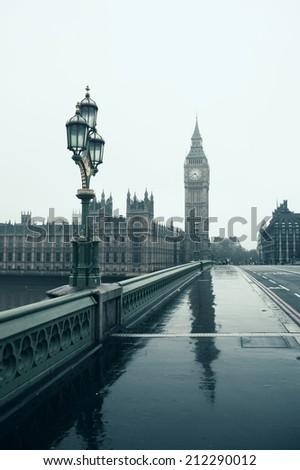 Westminster Bridge with the focus on Big Ben on a gloomy day. - stock photo