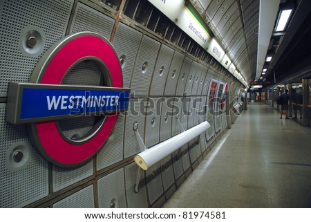 WESTMINSTER, LONDON, ENGLAND-JULY 16 : Underground Westminster tube station in London on July 16, 2006. The London Underground is the oldest underground railway in the world covering 402 km of tracks. - stock photo