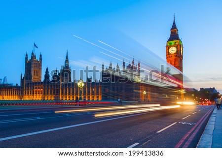 Westminster Palace and Big Ben with blue night sky and light trails of the traffic - stock photo