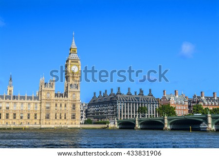 Westminster Palace and bridge against blue sky at Thames, London, UK - stock photo