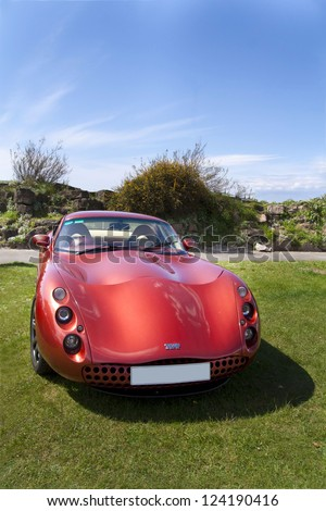 WESTON SUPER MARE, ENGLAND - MAY 6: Red TVR sports car on display at the Rally For Heroes show on May 6, 2012 in Weston Super Mare, England, Uk. - stock photo
