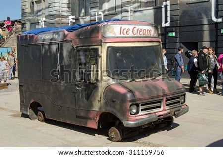 WESTON-SUPER-MARE, UK - AUGUST 26, 2015:  A burnt out ice cream van operating at the Dismaland parody theme park inspired by Banksy at the traditional seaside resort of Weston-Super-Mare.   - stock photo
