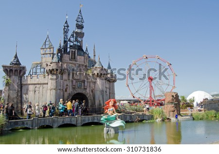 WESTON-SUPER-MARE, UK - AUGUST 26, 2015:  Mermaid sculpture distorted by a toxic lake outside the Castle at Dismaland, a parody park at the traditional seaside resort Weston-Super-Mare, Somerset. - stock photo