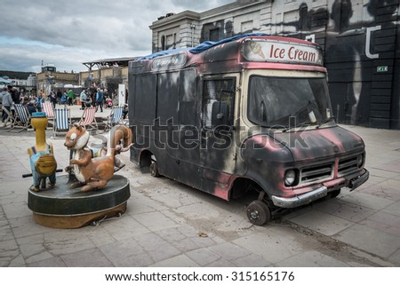 WESTON-SUPER-MARE, UK - SEPTEMBER 3 2015: Burnt out ice cream van at Banksy's Dismaland Bemusement Park. A five week show in the seaside town of Weston-Super-Mare. - stock photo