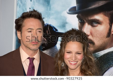 "WESTWOOD, CA - DECEMBER 6: Actor Robert Downey Jr. and producer Susan Downey arrive at the premiere of ""Sherlock Holmes 2 : A Game of Shadows"" on December 6, 2011 in Westwood, California - stock photo"