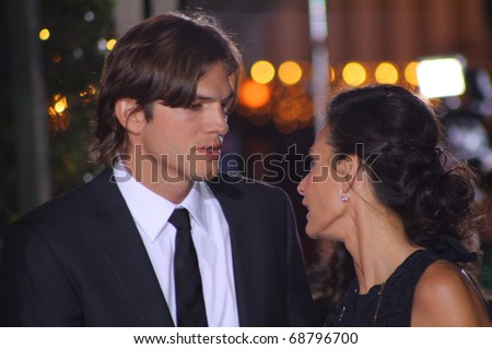 WESTWOOD - JANUARY 11: Couple Ashton Kutcher and Demi Moore arrive at the premiere of his new movie No Strings Attached at the Regency's Village Theatre on January 11, 2011 in Westwood, CA. - stock photo