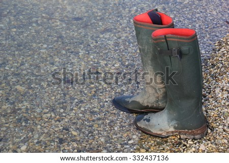 wet and dirty Gum Boots - stock photo