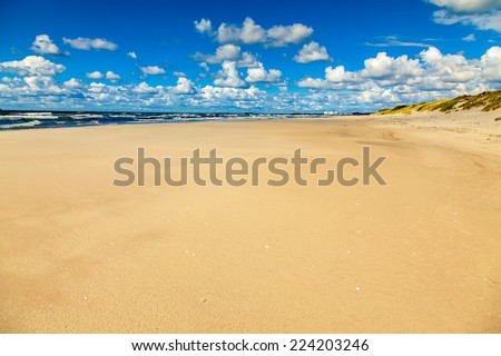wet beach at the Baltic sea in early autumn - stock photo