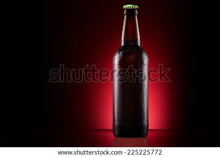 wet beer bottle on a colored background - stock photo