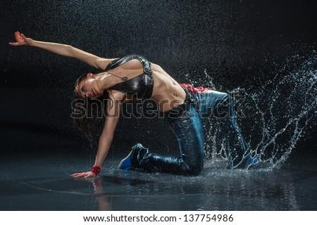 Wet dancing woman. Under water drops. Studio photo - stock photo