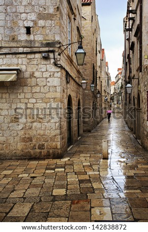 Wet Dubrovnik side alley at dawn - stock photo