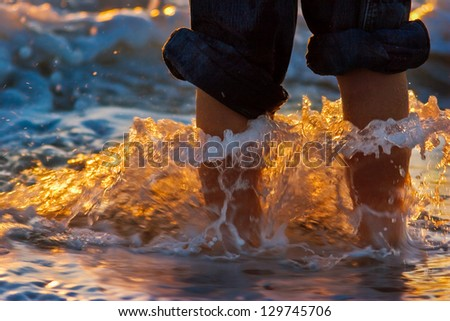 Wet Feet with waves crashing