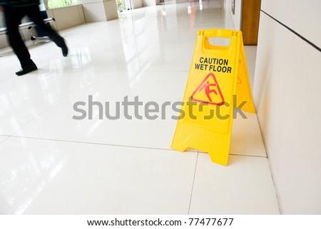 Wet floor caution sign on floor - stock photo