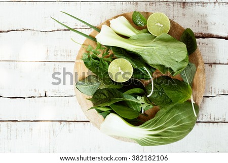 wet fresh greenery on cutting board. Diet salad, detox drink ingredients. Healthy food background. Text space - stock photo