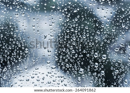 Wet glass with droplets, dark blue photo background with selective focus