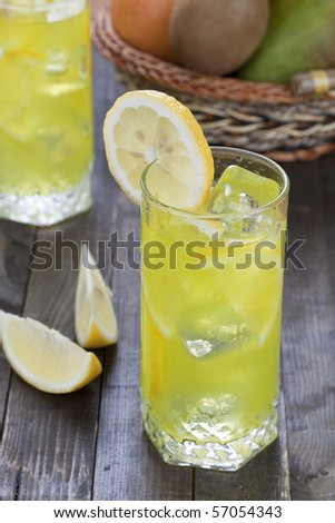 Wet glass with slices of lemon - stock photo