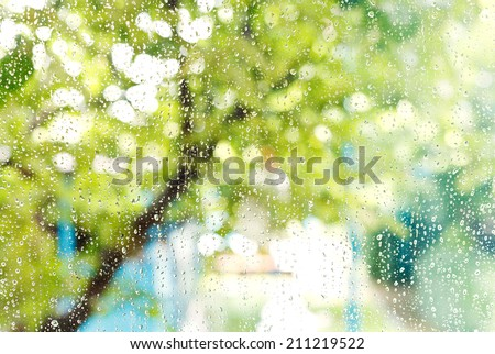 wet home window with raindrops after summer rain - stock photo
