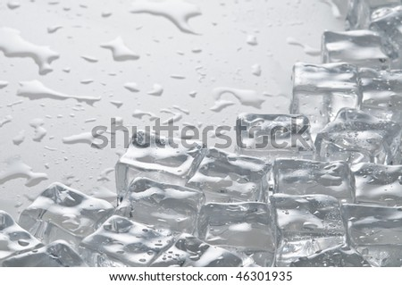 Wet ice cubes objects over water surface - stock photo