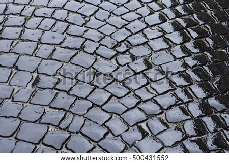 Wet pavement stone blocks in rainy weather in Lviv, Ukraine. Pavement stone blocks can be used as a background