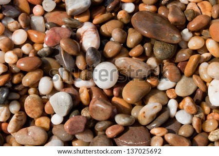 wet pebbles on the ocean shore - stock photo