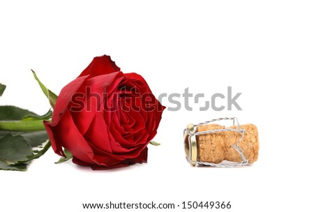 wet red rose and a cork