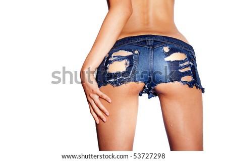 Wet ripped tiny denim booty shorts - stock photo