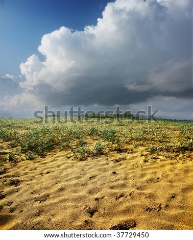 Wet sand and storm clouds