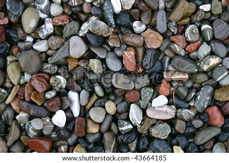 wet stones on the beach used as background - stock photo