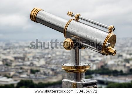 Wet telescope on top the Eiffel Tower - stock photo