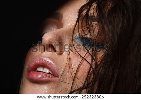 Wet woman portrait with water drops on the face