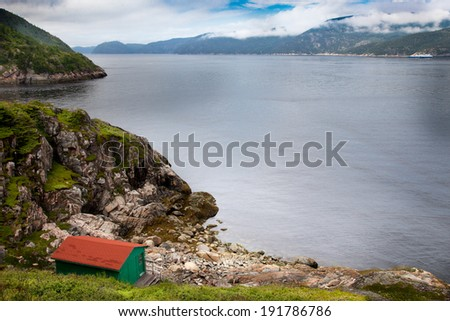 Whales watching houses along the Saint Lawrence River, Quebec, Canada - stock photo