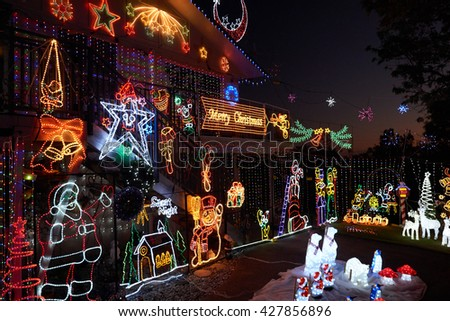 WHANGAREI, NEW ZEALAND - DECEMBER 2015: Merry Christmas house decorations lit up at night. - stock photo