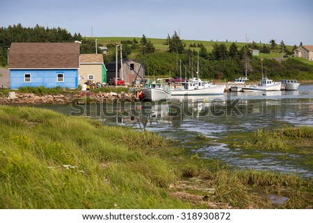 Wharf and fishing boats in French River, Prince Edward Island. - stock photo