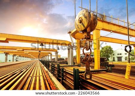 Wharves, bridge cranes and rails. - stock photo
