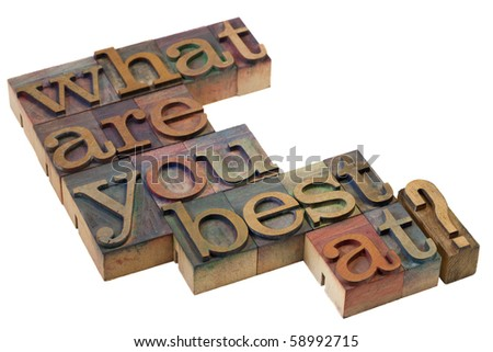 what are you best at question in vintage wooden letterpress printing blocks, stained by color inks - stock photo