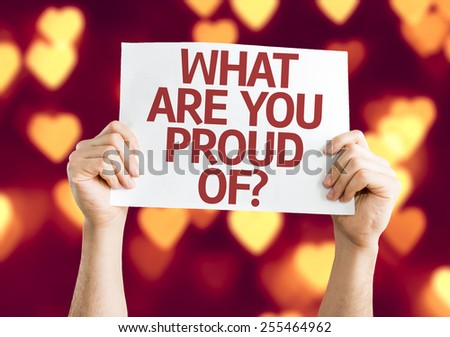 What Are You Proud Of? card with heart bokeh background - stock photo