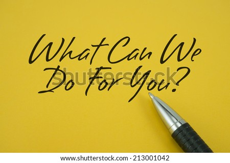 What Can We Do For You! note with pen on yellow background - stock photo