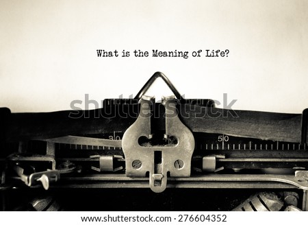 What is the meaning of life message typed on a vintage typewriter - stock photo