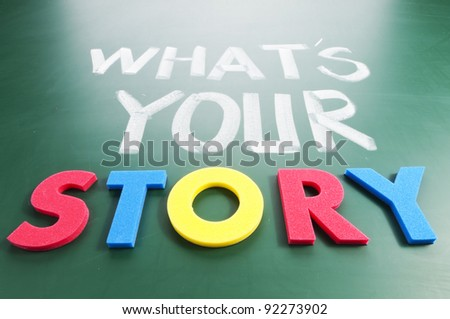 What is your story? Colorful words on blackboard. - stock photo
