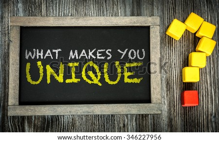 What Makes You Unique? written on chalkboard - stock photo
