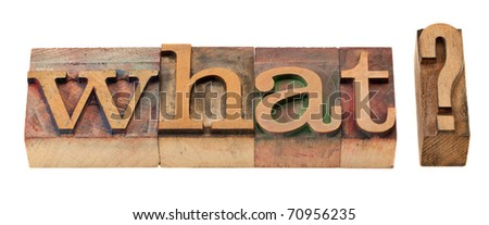 what question in vintage wood letterpress printing blocks, stained by color inks - stock photo