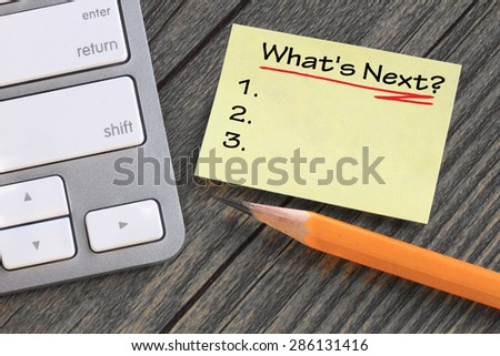 what's next note, planning concept with desk background - stock photo