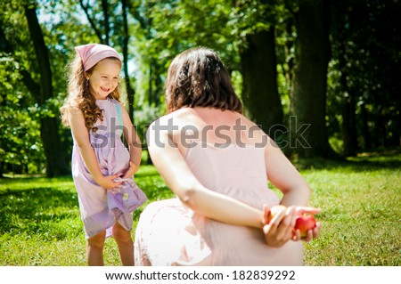 What to choose - mother with child - stock photo