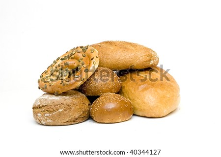Wheat and bread on a white background